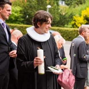 Pastor mit Kerze